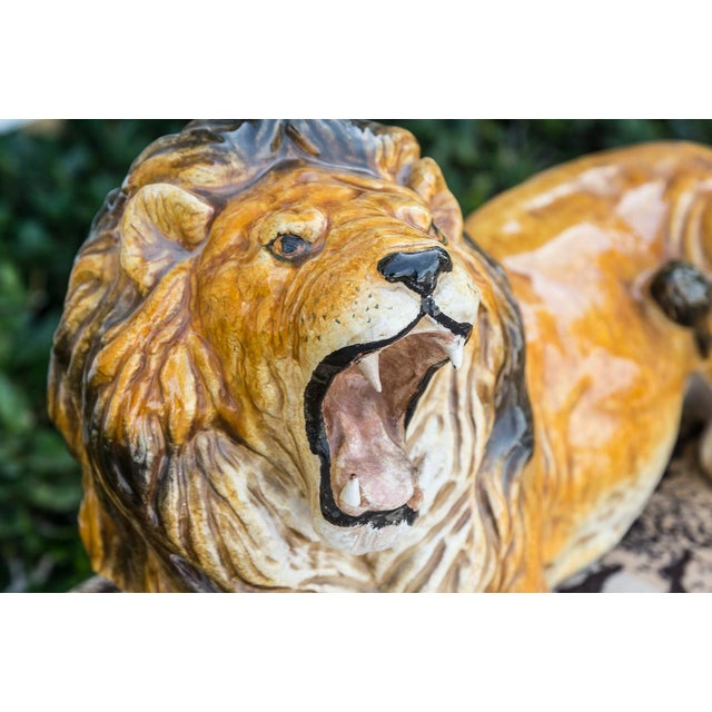 Glazed terra cotta large crouching lion. Marked made in Italy. In very good condition with no damage. Measures: 16 inches...