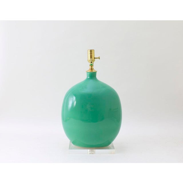 "The MARFA lamp is shown in our Glossy Aqua Marine glaze. Signed by Paul Schneider. Lead time three weeks. LAMP BODY 16"" H..."