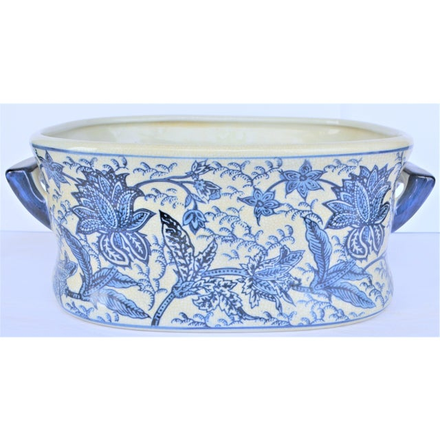 This is a very versatile Chinoiserie footbath , bowl or planter. It is in a vibrant botanical Asian pattern. This is a...