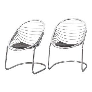Gastone Rinaldi Chrome Egg Armchairs - a Pair