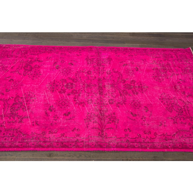Vintage hand-knotted overdyed rug with an allover floral motif. This piece has great colors and a beautiful design. It...