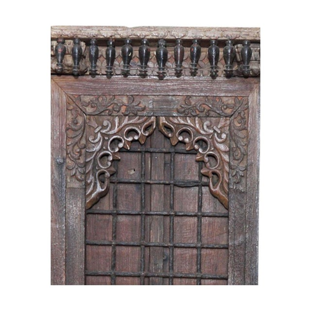 19th Century Anglo Indian door with an indented carved frame, metal strap work, and brass nailheads.