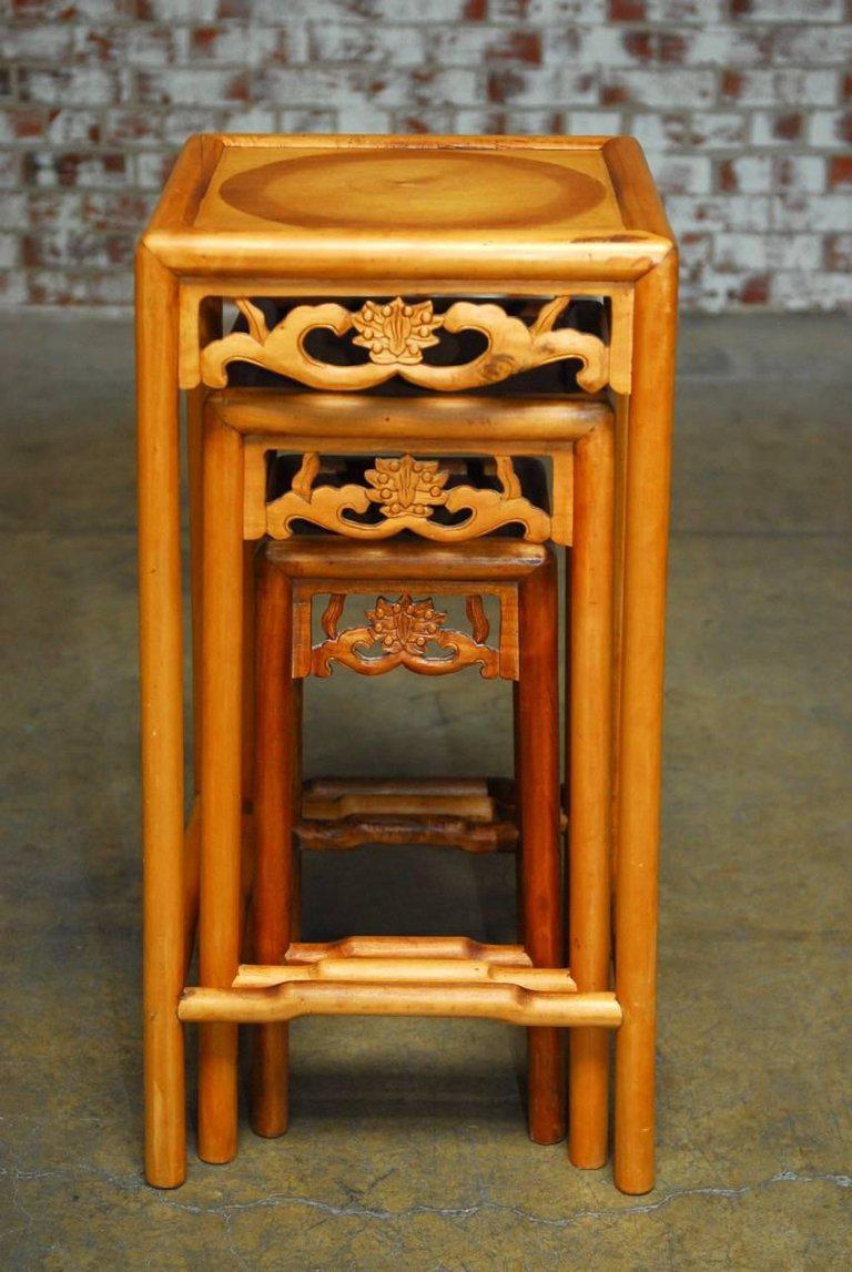 Large Set Of Three Carved Chinese Nesting Tables Or Stacking Tables  Featuring A Lotus Blossom Decoration