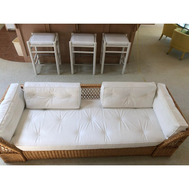 Natural wicker frame couch with white cushions from The McGuire Company, c. 1990. This is a really nice piece that lived...