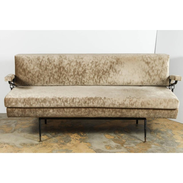 Adjustable Mid-Century Italian sofa that converts into daybed. The arms lift allowing conversion into sleeper with blanket...