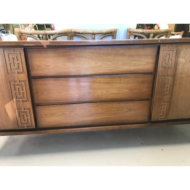This buffet is in good vintage condition. A few scuffs here and there. Would be beautiful lacquered.