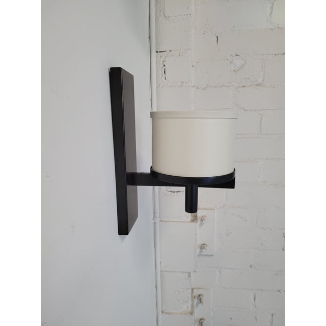 """Silk Drum Sconce shown in oil rubbed bronze and vanilla silk pongee shade. Shade measures 6""""diam, 4.5""""h Ready to install...."""