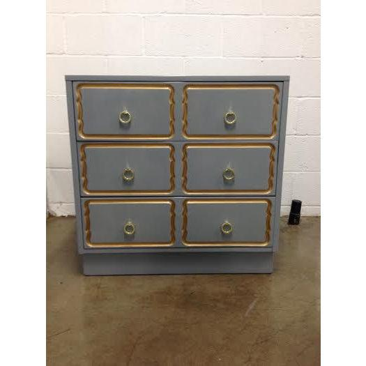 Channel your inner Dorothy Draper with this super cute blue-gray vintage chest of drawers. It has been completely redone...