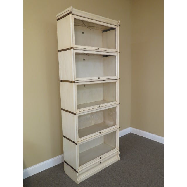 Globe-Wernicke white decorated stack barrister bookcase. Features solid brass hardware and bands, retracting glass doors,...