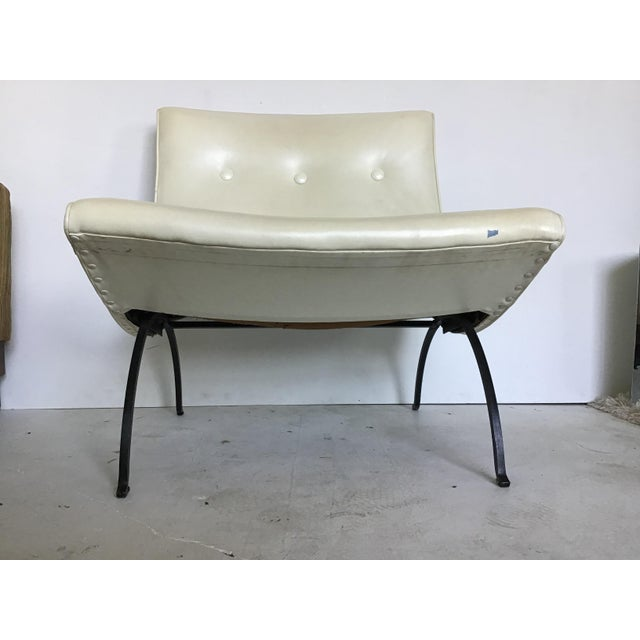 This is a Super nice original condition version of a Milo Baughman scoop chair. It has wrought iron arched legs. This...
