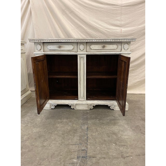 Beautiful Tuscan painted buffet, with a tone on tone neutral patina. Featuring two doors over two cabinet doors, this...