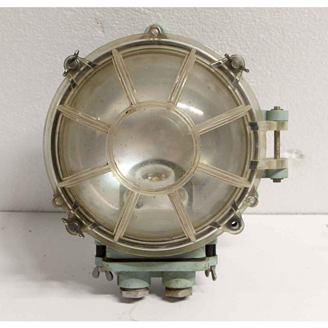 Green and clear lucite face nautical sconce. Price includes restoration. The manufacturer and exact date of creation are...