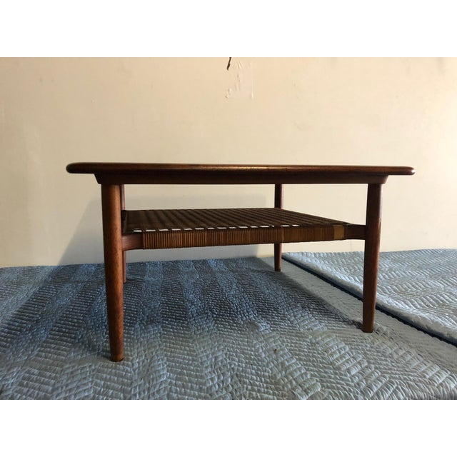 """Johannes Andersen midcentury rattan shelf coffee table. Marked """"Made in Denmark"""" and imprinted with the Los Angeles..."""