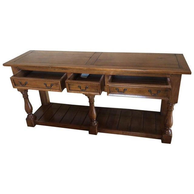 French country charming large wooden sideboard or buffet, probably teak, having 3 turned legs in front, second planked...