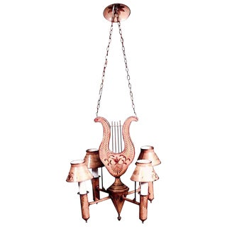 French Directoire Style Mustard Tole and Gilt Trimmed Four-Arm Chandelier For Sale