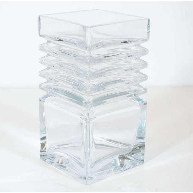 This stunning vase features a rectalinear stepped design in translucent crystal. It embodies the clean lines of...