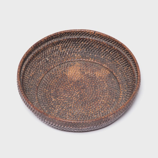 Tightly woven of natural reeds, this neat basket likely contained offerings of food, money and fruits presented as part of...