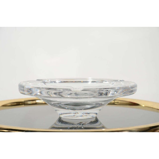 Large handblown crystal ashtray or bowl with streamline mid-century modern design. Series # 71577. Signed Lindstrand for...
