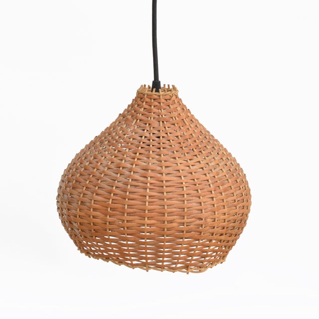 Ceiling lamp in the style of Scandinavian modernism made in Denmark in the 1960s. Chandelier with a wicker shade wiring in...
