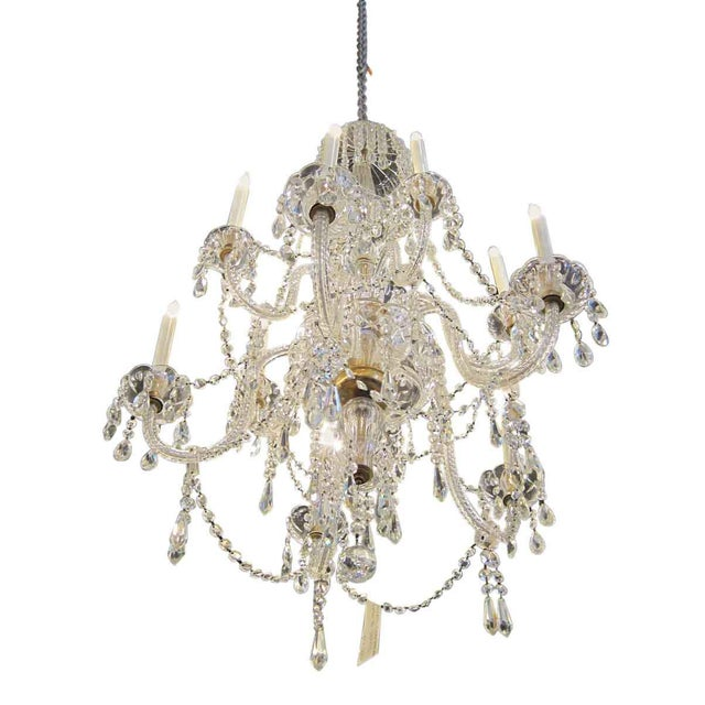 This light features an abundance of icicle crystals with brass finishes. This item can be viewed at our Madison Avenue NYC...