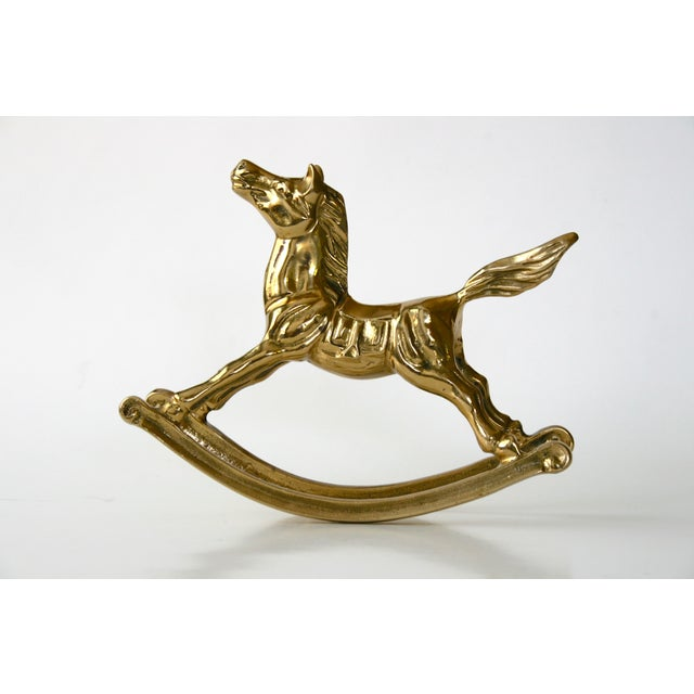 "Adorable vintage solid brass rocking horse. Terrific addition to a ""brass menagerie"" or a sweet decor accent to a nursery."