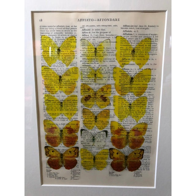 16 yellow butterflies printed on a Italian dictionary page. These prints were purchased in a gallery in Bruges, Belgium....