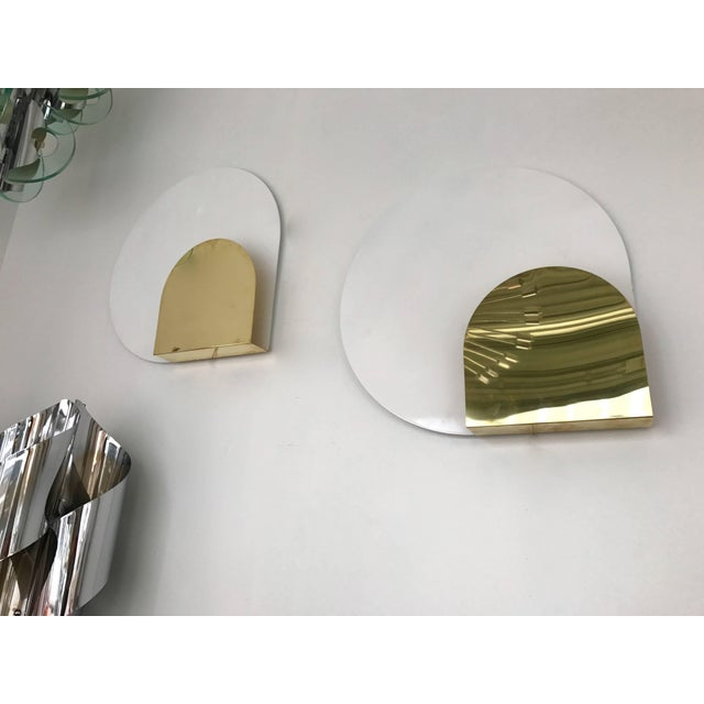 Pair of sconces or wall light by the designer Pia Guidetti Crippa for the editor Lumi Milano. White lacquered metal disc,...