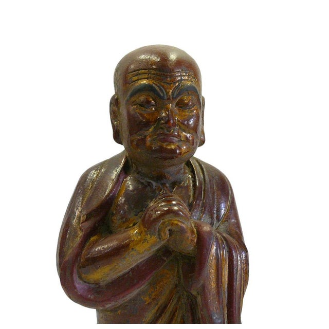 This is a decorative Chinese monk Lohon figure made of wood and painted with a brown lacquer golden accent color....