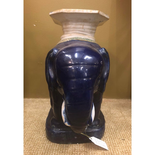 A vintage ceramic Chinese elephant garden stool in navy.