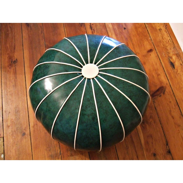 This is SUCH a great retro footstool! The stool features malachite colored green mottled vinyl material with contrasting...