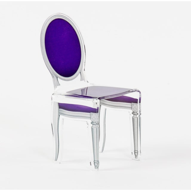"This ""Sixteen"" acrylic chair in purple is inspired by Louis XVI styled chairs, but adds a very contemporary and sleek..."