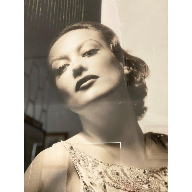 This large scale photograph of the iconic, Hollywood movie star Joan Crawford was originally taken in 1932 by George...