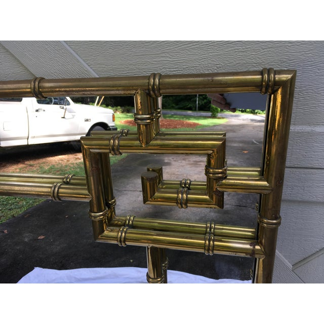 1970s faux bamboo brass mirror, by Mastercraft, with Greek Key design. Very stylish and well made.