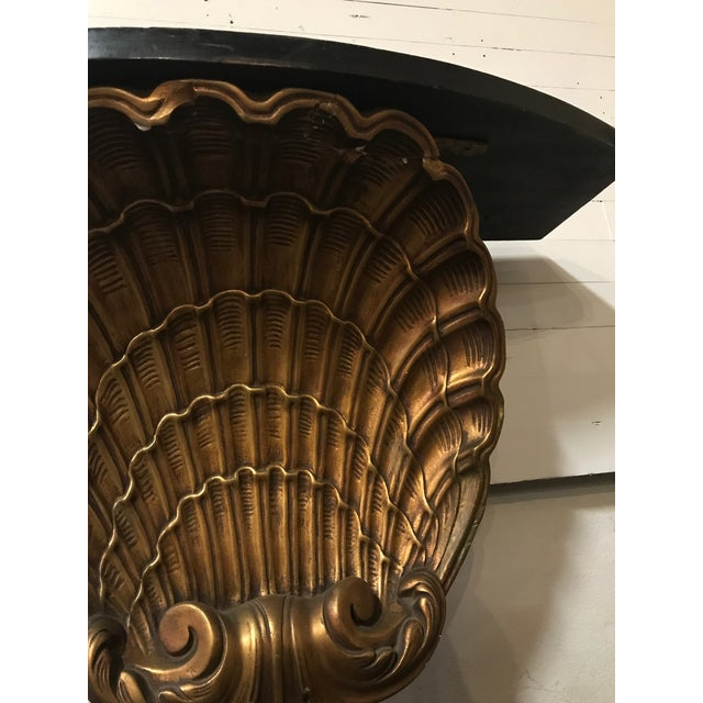 Gilded shell console table by Grosfeld House. Eye catching and a sure way to liven up an entry way or living room with...