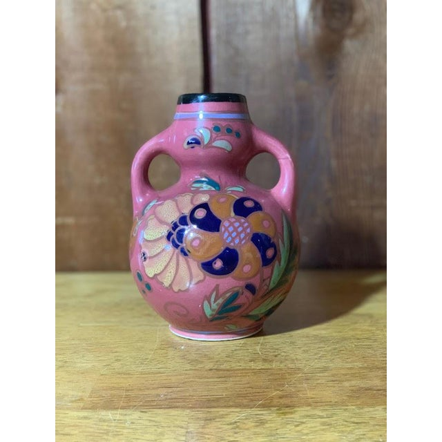"Pretty French pink colored vase marked ""Made in Japan"" on the base. This vase is in good condition. There is glaze..."