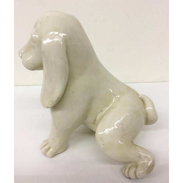 Purchased from a Paris antique shop in the 70's. This little doggie is in mint condition. A nice creamy white porcelain...