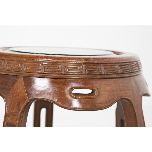 An early 20th century Chinese stool with hard stone seat. Period: 20th Century Region: China Materials: Stone / Mineral /...
