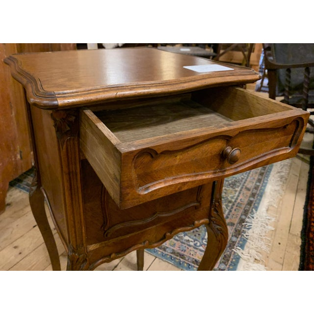 French bedside single door cabinet with one drawer. Features shaped top and good color.