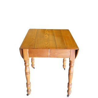 19th Century Early American Oak Drop Leaf Dining Table Turned Leg Casters For Sale