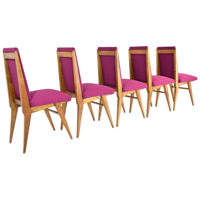 French 20th century vintage high back art deco dining chairs composed of solid oak and splayed - tapered legs in the style...