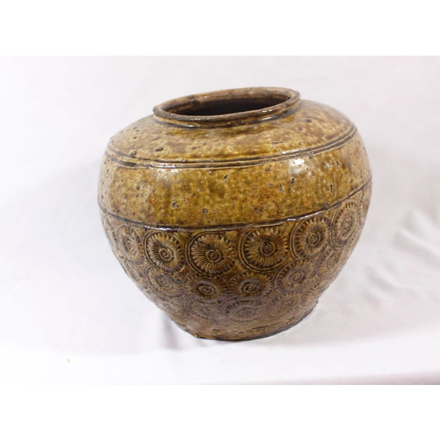 This is an antique early 19th century Thai vessel in gorgeous olive green/ochre yellow glaze with a beautiful repeated...
