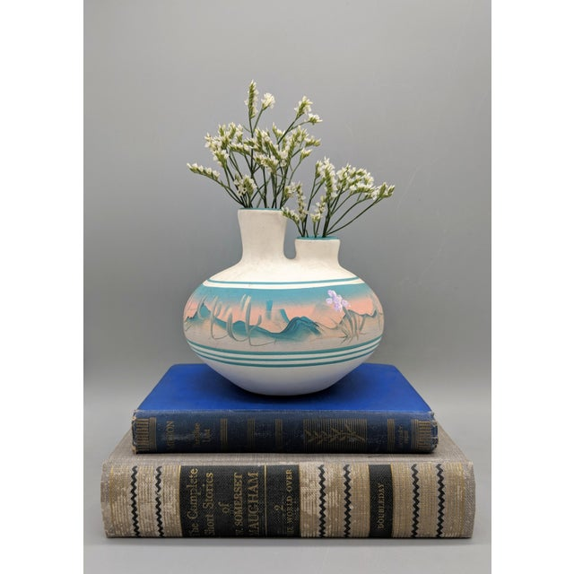 Beautifully shaped double vase with matte finish by New West Pottery in Arizona. Hand painted with bands and dessert scene...