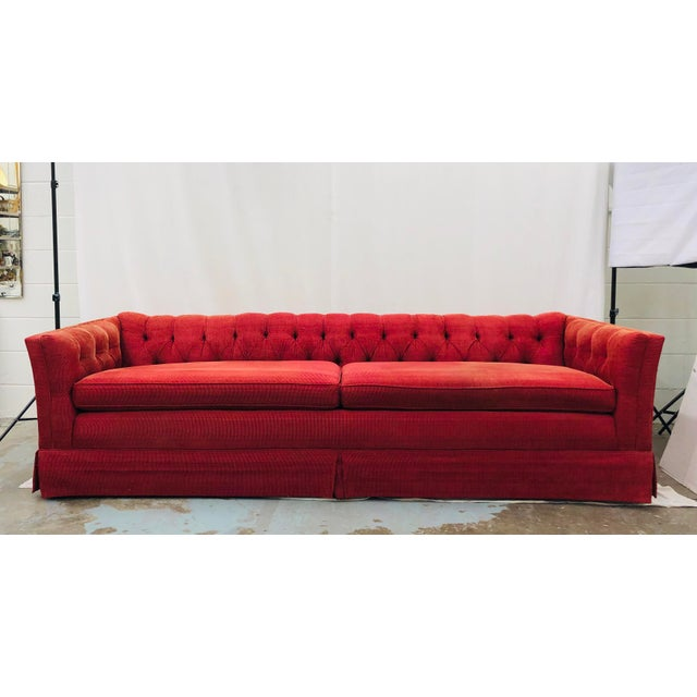 Stunning Vintage Chesterfield Style Tufted Button Back Sofa, upholstered in original raspberry colored red fabric. Two...