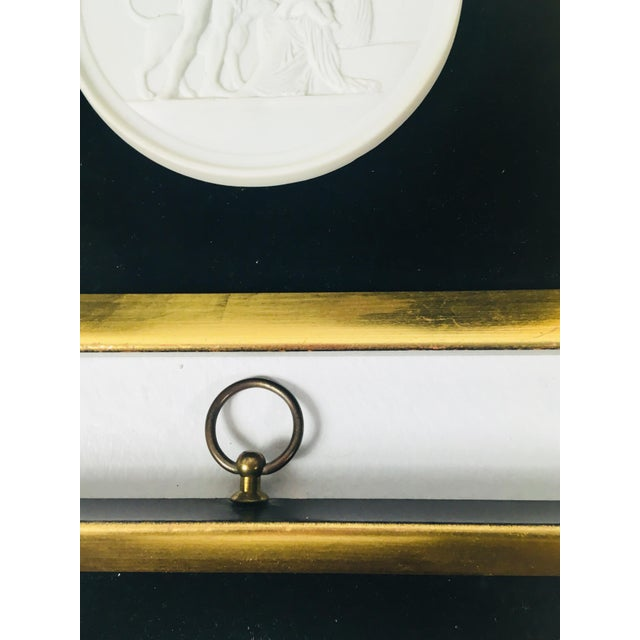 This is a pair of bisque porcelain plaques. They are Royal Copenhagen. Framed in gold leaf frames with black velvet...
