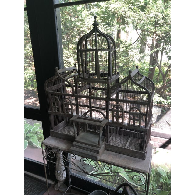 Antique Victorian iron wire and painted wood mansion style English folk art bird cage on stand. There are remnants of the...