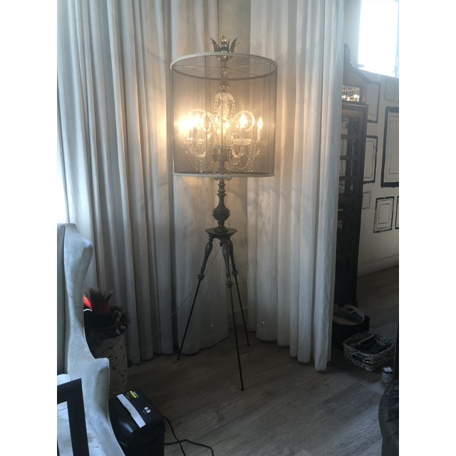 Beautiful handmade metal and brass floor lamp, with full six light crystal chandelier with mesh shade trimmed with...