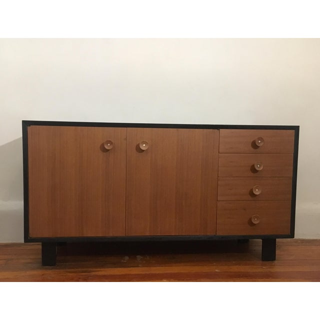 Rare 2 tone walnut and ebonized credenza designed by George Nelson for Herman Miller, 1950's. Beautiful example with...