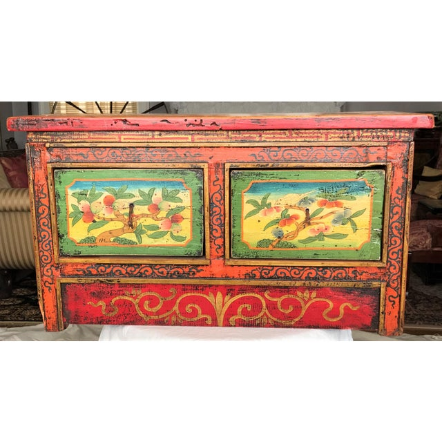 Beautifully embellished two drawer, century-old Tibetan chest features magnificent Buddhist artistry from the late 19th or...