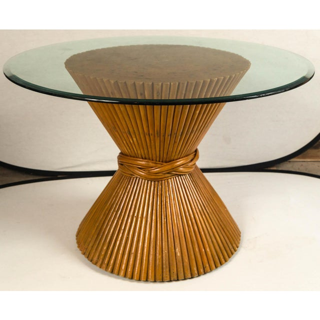 Vintage McGuire bamboo pedestal table. Sheaf of wheat design base with glass top. Original finish with aged patina. An...