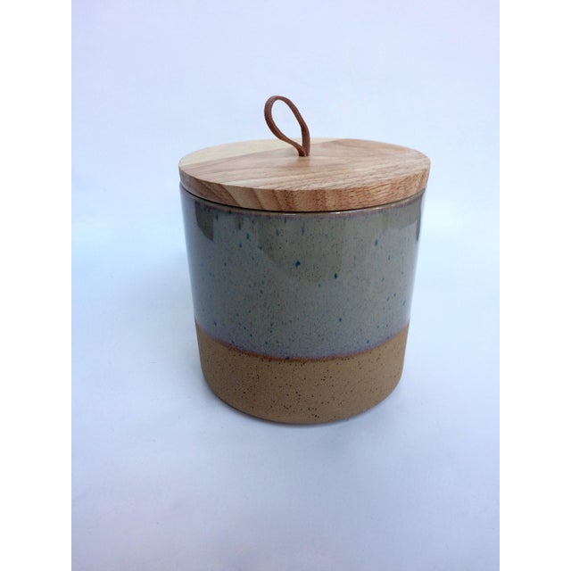 Medium, two-tones speckled earthenware canister. Glossy dark gray with blue speckles on the top section and brown matte on...
